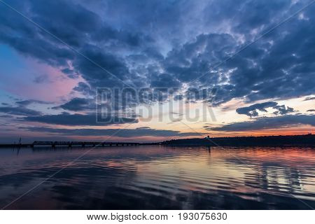 Sunset during blue hour over Volga River and Bridge, located in Ulyanovsk Russia.
