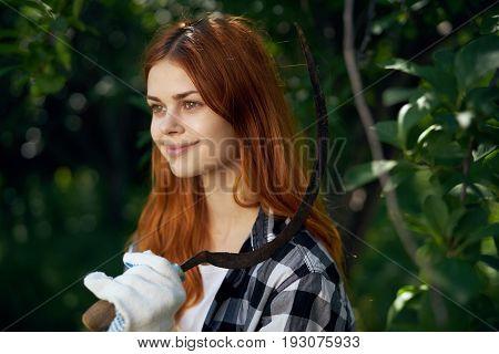 Young beautiful woman running in the garden, gardener.