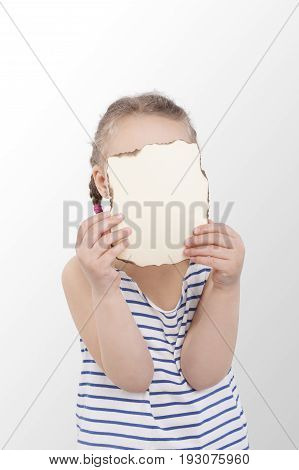 Small captain girl looking at map isolated on white background.
