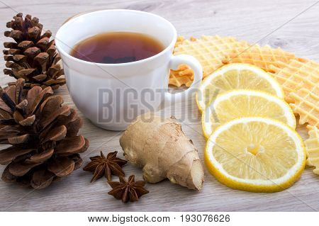 Cup Of Tea With Pinecone, Badian, Ginger, Waffles And Cinnamon