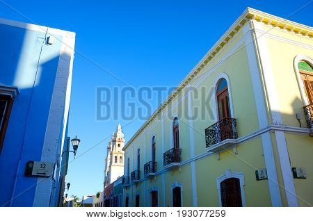 Colonial street corner in Campeche Mexico with a beautiful blue sky