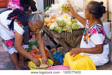 VALLADOLID MEXICO - FEBRUARY 11: Women selling fruit on the street in Valladolid Mexico on February 11 2017