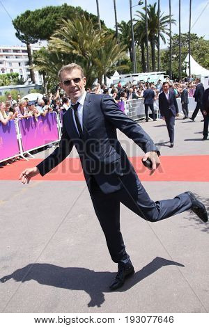 Lambert Wilson attends the 70th Anniversary photocall during the 70th annual Cannes Film Festival at Palais des Festivals on May 23, 2017 in Cannes, France.