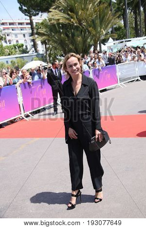 Sandrine Bonnaire attend the 70th Anniversary photocall during the 70th annual Cannes Film Festival at Palais des Festivals on May 23, 2017 in Cannes, France.