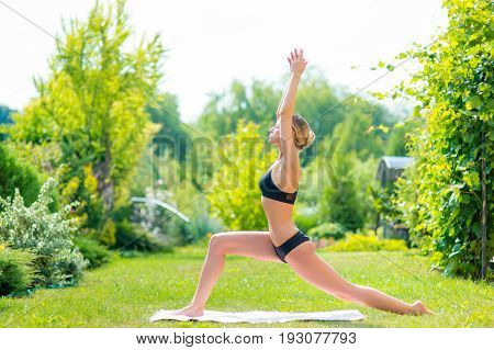 Woman stretching practicing yoga outdoors, Woman practicing yoga outdoors