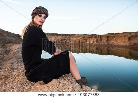 girl on a shore of oasis in desert