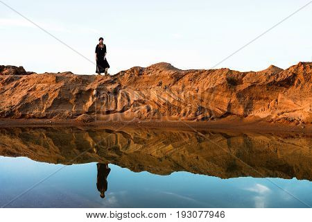 reflection of a girl in oasis in desert