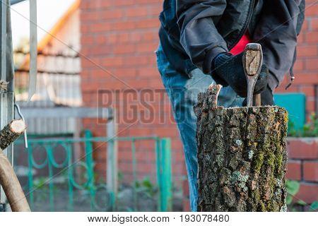 Splits Firewood The Axe. The Man Splits The Axe Wood.