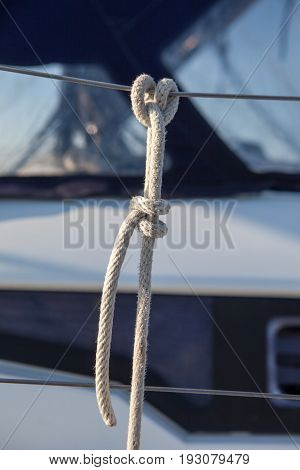The rope tied to the railing on the boat clove hitch, the method of attaching fenders