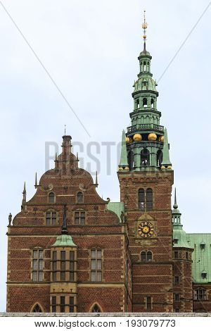 HILLEROD, DENMARK - JUNE 30, 2016: This is fragment of the facade of the Frederiksborg Castle the residence of the Danish kings one of the masterpieces of the Scandinavian Renaissance.
