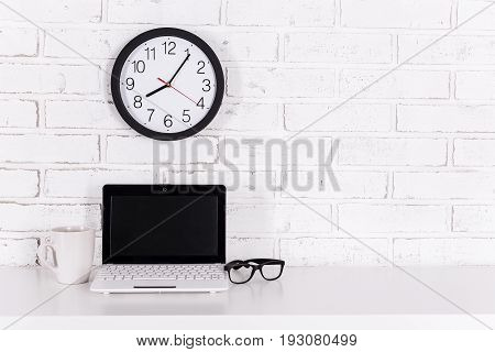 Workplace At Home Or In Office - Modern Laptop, Glasses, Cup Of Coffee And Office Clock Over White W
