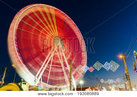 Rotating Ferris wheel in motion located in Badajoz Extremadura Spain