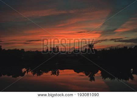 July sunset with clouds reflected in the river Hoper.