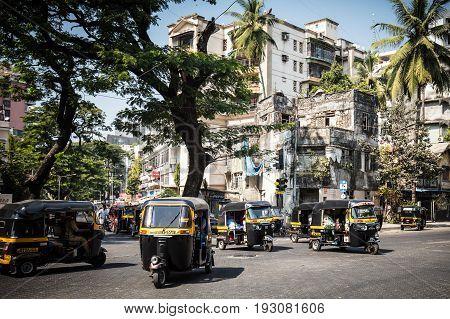 MUMBAI, INDIA - November 6 2017: Rickshaw traffic in Bandra on a hot summer's day in Mumbai, India