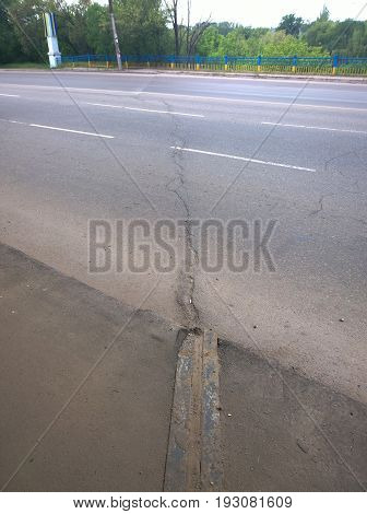 A crack across the entire roadway of the highway in the city of Krivoy Rog in Ukraine