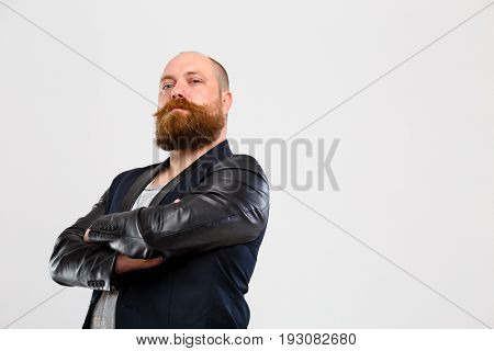 Brutal man with arms folded