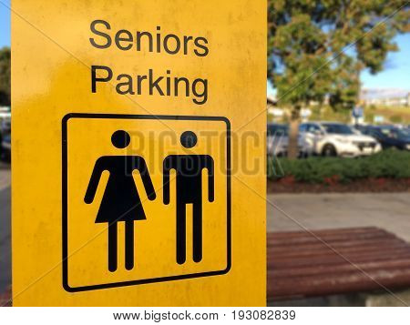Senior Parking sign in a public parking lot. Elderly lifestyle concept. copy space