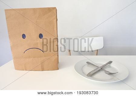 Eating disorder concept or sad face unhappy with meal or sad face unhappy because there is no food to eat. Copy space