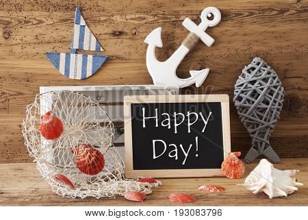 Blackboard With Nautical Summer Decoration And Wooden Background. English Text Happy Day. Fish, Anchor, Shells And Fishnet For Maritime Contex.