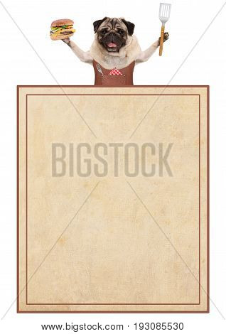happy pug dog wearing leather bbq apron holding hamburger and spatula with old vintage paper menu card isolated on white background