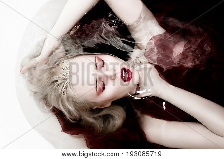 Halloween Scene Of An Immortal Female Vampire In A Bloody In A Slaughter Bath With Black Eyes