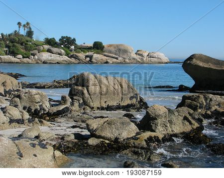 FROM CLIFTON CAPE TOWN, SOUTH AFRICA, HUGE BOULDERS IN THE FORE GROUND AND THE BACK GROUND  33jtfg