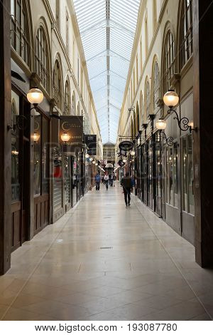 PARIS, FRANCE - June 08, 2017: Interior of Passage Choiseul - shopping area with clothing stores, book stores, jewelers shops and art galleries.