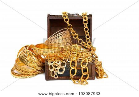 Accessorys and gold jewelry in wooden jewel chest, over white