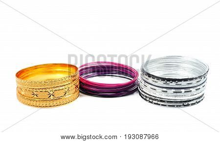 Golden, silver and painted  bracelets , over white background
