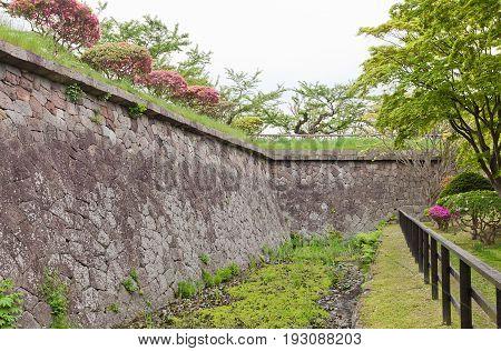 HAKODATE JAPAN - MAY 24 2017: Stone walls (ishigaki) and moat of Goryokaku Fort in Hakodate Hokkaido Island Japan. Fort was erected in 1855 destroyed in 1869 during last battle of Boshin War