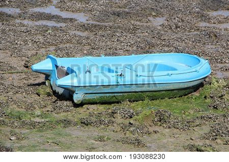 Boat tender on silt in a harbor in Brittany