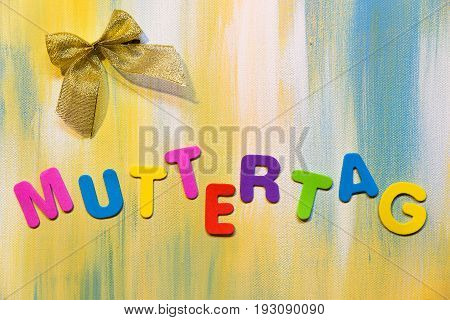 Colorful Letters And Ribbon, German Word, Concept Mother´s Day
