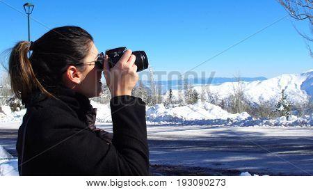 Tourist travel photographer photographing Farellones Ski Station in Santiago, Chile
