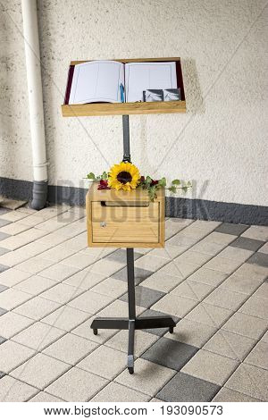 Condolences Book with Sun Flower and Ivy on bright background