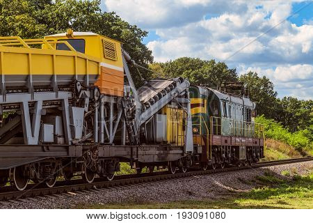 Diesel shunting locomotive with a wagon for construction and repair of railway tracks