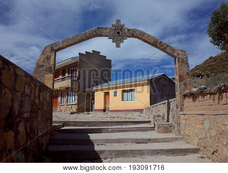 An archway with an Inca Cross in a traditional community on the Isla del Sol on Lake Titicaca