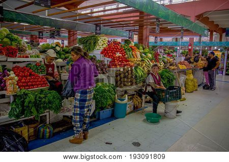 QUITO, ECUADOR - NOVEMBER 23, 2016: Unidentified people buying food, vegetables and fruits at the municipal market located in Saint Francis.