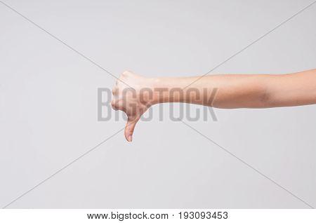 Human hand showing thumb down. thumb down