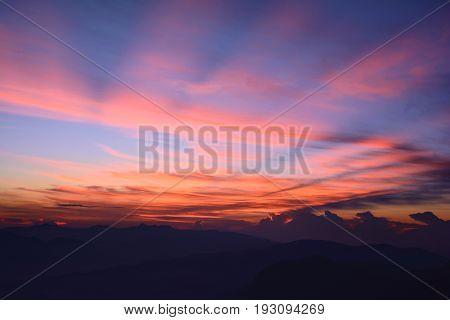 First rays of the rising sun. Misty mountains in the morning. Sunrise at the Adam's Peak (Sri Pada Mountain) Sri Lanka
