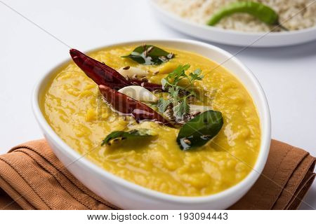 Indian popular food Dal fry or traditional Dal Tadka Curry served with jeera rice, isolated over white background, selective focus