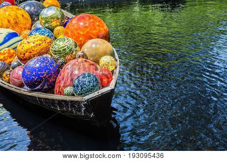 BRONX, NY, USA - JUNE 9, 2017: NY BOTANICAL GARDEN.  Dale Chihuly's art exhibition displayed at NYBG.  Shown here is his boat installation entitled Float Boat.