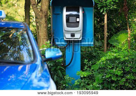 closeup of electric car charging at station