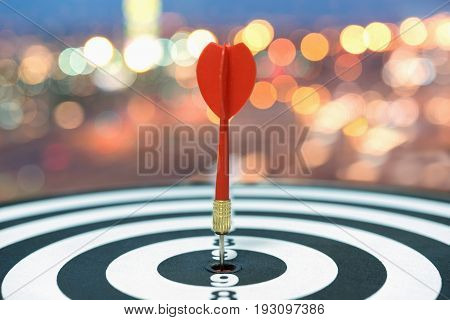 Red dart target arrow hitting on bullseye over blurred bokeh light background Metaphor to accuracy in business success concept Marketing conceptual
