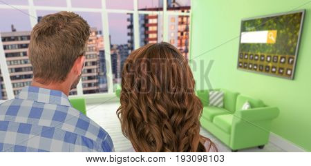 Rear view of young couple standing against composite image of modern living room