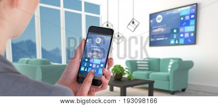 Close-up of businesswoman using mobile phone against blue sofas in modern living room