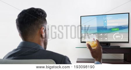Rear view of businessman holding whisky glass against various computer icons with progress bar