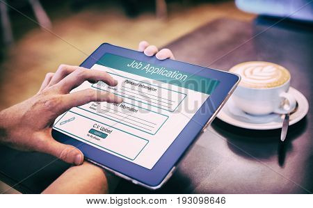 Digitally generated image of Job Application  against  close-up of digital tablet and coffee on table Close-up of digital tablet and coffee on table in the coffee shop