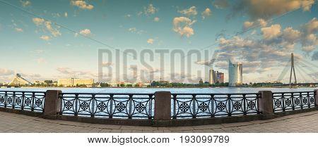 RIGA, LATVIA - JUNE 25, 2017: Panoramic view on the left bank of Daugava river, Riga, Latvia