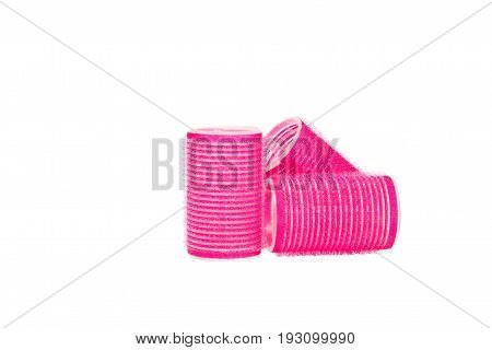 Pink hair curler isilated on white background