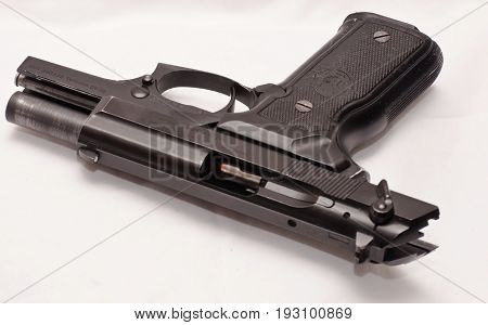 A black semi automatic pistol with the slide locked open